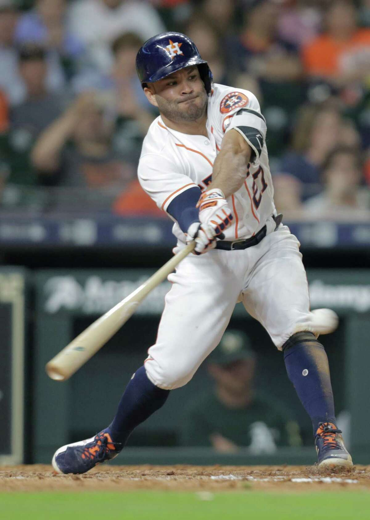 Houston Astros second baseman Jose Altuve (27) connects for a single in the eighth inning against the Oakland Athletics at Minute Maid Park on Saturday, April 28, 2018, in Houston. Houston Astros won the game 11-0 and tied the series 1-1.