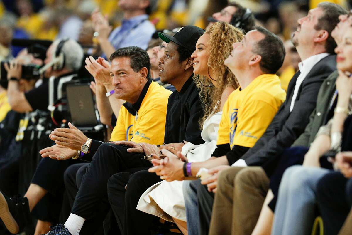 Jay-Z and Beyonce watch the first quarter during game 1 of round 2 of the Western Conference Finals between the Golden State Warriors and the New Orleans Pelicans at Oracle Arena on Saturday, April 28, 2018 in Oakland, Calif.