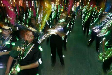 Members of the McCollum High School Cowboy Band perform during the 2018 Fiesta Flambeau Parade. While the parade officially began in 1948, the idea of an illuminated nighttime parade may have originated from sculptor Pompeo Coppini in 1905.
