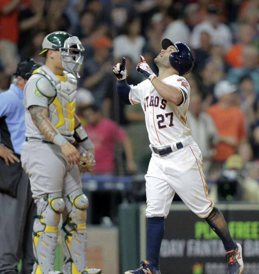 Jose Altuve reacts as he crosses home plate after hitting a solo home run in the sixth inning against Oakland's Wilmer Font. Altuve finished 4- for 5. Photo: Elizabeth Conley, Staff / Houston Chronicle / © 2018 Houston Chronicle