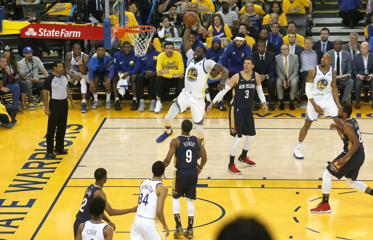 Warriors Draymond Green,23 with a first half slam as the Golden State Warriors take on the New Orleans Pelicans in game one of the second round playoffs of the Western Conference finals at Oracle Arena in Oakland, Ca. on Sat. April 28, 2018.