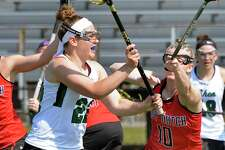 Shenendehowa's #22 McKenzie Ballard, left, fires off a shot to score as Guilderland #10 Courtney Rafferty defends during Saturday's game April 28, 2018 in Clifton Park, NY. (John Carl D'Annibale/Times Union)