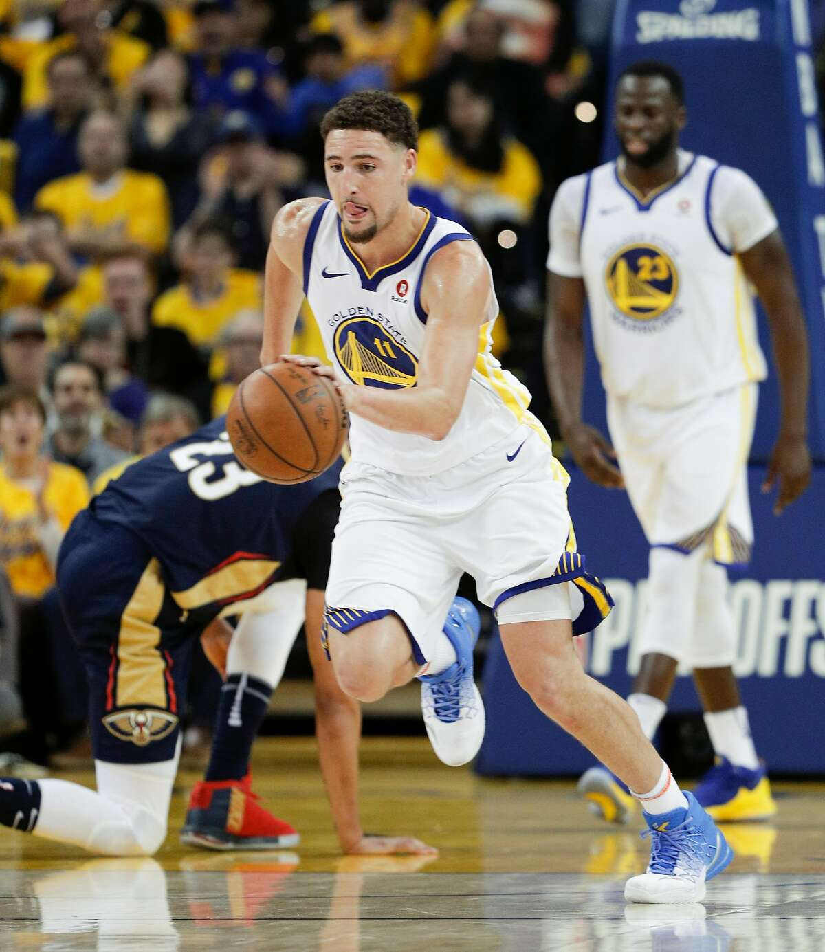 Golden State Warriors' Klay Thompson brings the ball up court in the second quarter during game 1 of round 2 of the Western Conference Finals between the Golden State Warriors and the New Orleans Pelicans at Oracle Arena on Saturday, April 28, 2018 in Oakland, Calif.