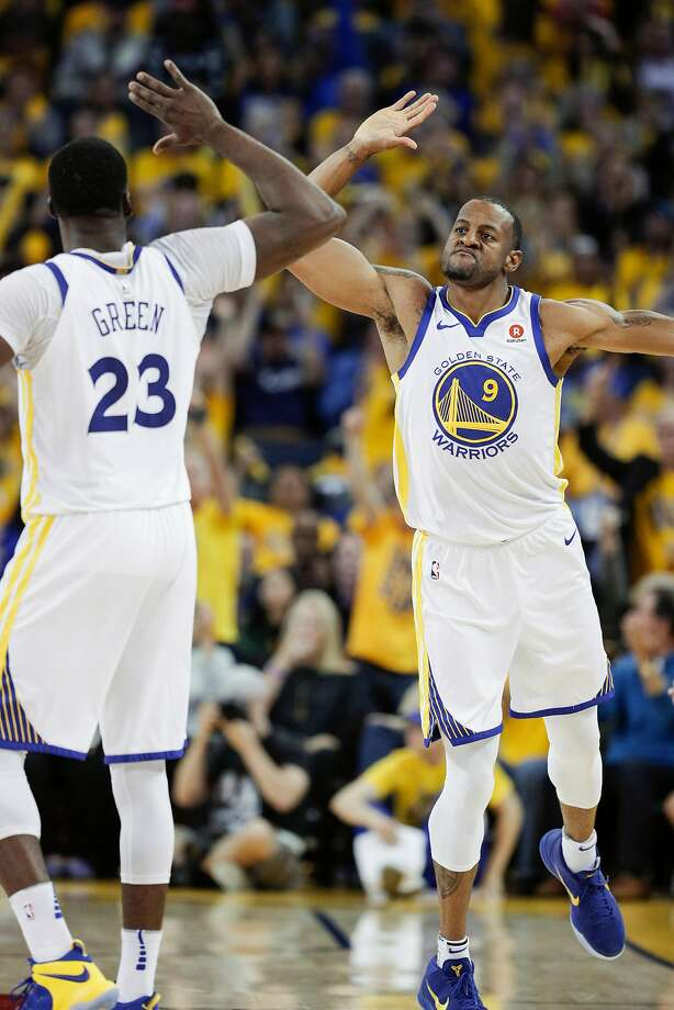The Warriors' Draymond Green and Andre Iguodala high-five in the third quarter during a Game 1 rout against the Pelicans. Photo: Carlos Avila Gonzalez / The Chronicle