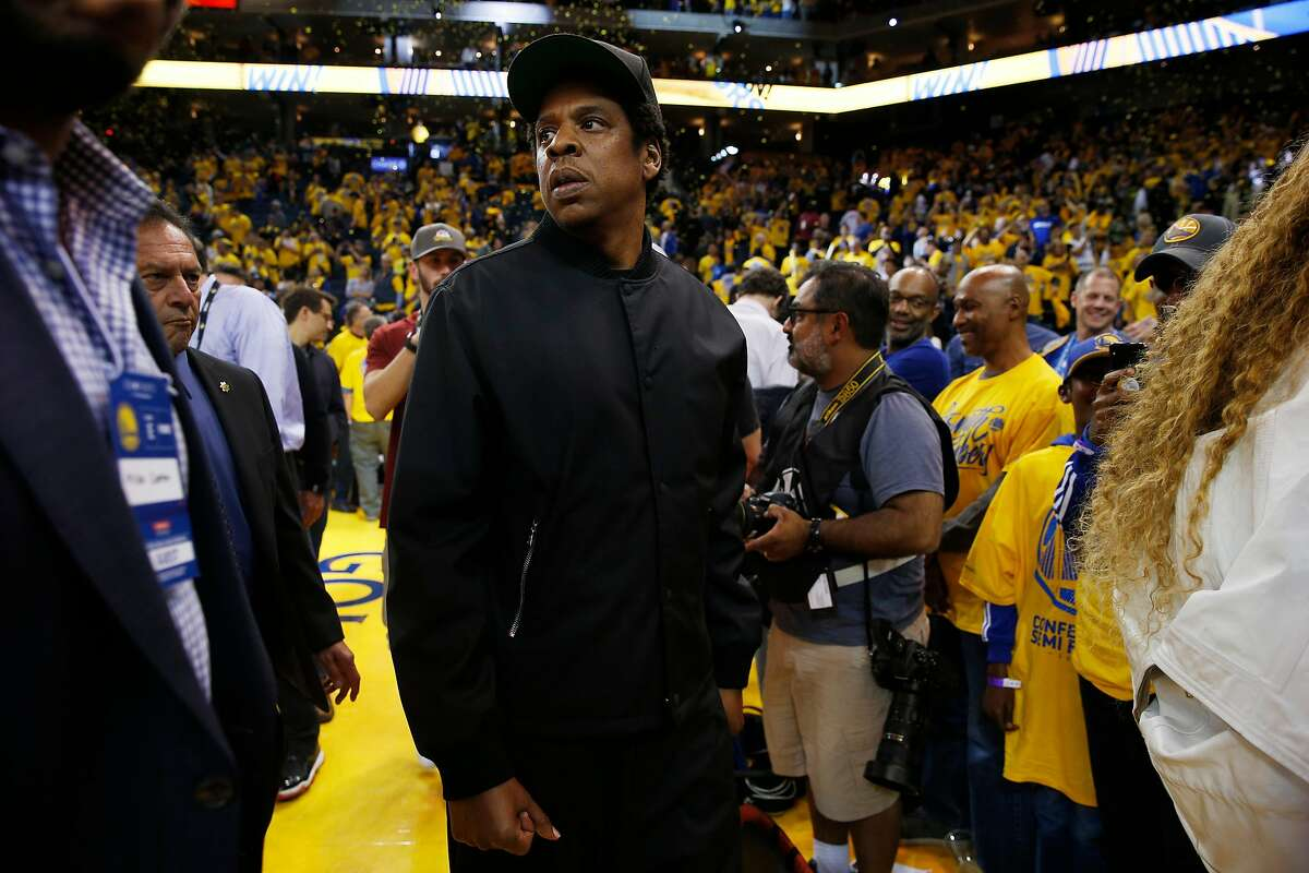Jay-Z heads out with Beyonce after the end of Round 2 Game 1 of the NBA Western Conference Finals between the Golden State Warriors and New Orleans Pelicans at Oracle Arena Saturday, April 28, 2018, in Oakland, Calif.