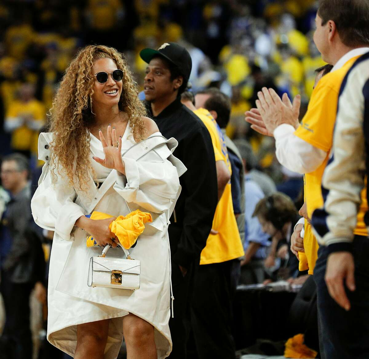 Beyonce waves good-bye to Joe Lacob in the fourth quarter during game 1 of round 2 of the Western Conference Finals between the Golden State Warriors and the New Orleans Pelicans at Oracle Arena on Saturday, April 28, 2018 in Oakland, Calif.