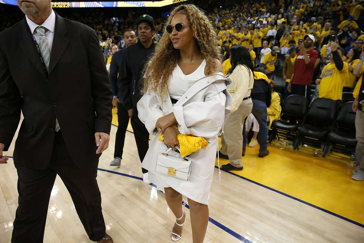 Beyonce and Jay-Z exit following the end of Round 2 Game 1 of the NBA Western Conference Finals between the Golden State Warriors and New Orleans Pelicans at Oracle Arena Saturday, April 28, 2018, in Oakland, Calif.