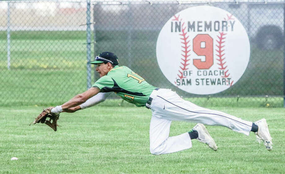 Southwestern center fielder Jack Little dives just shy of a Calhoun single Saturday during a three-team baseball cluster in Gillespie. The play comes in front of a sign on the outfield fence honoring former Miners coach Sam Stewart with the retiring of his No. 9. Stewart died in January 2017. Photo:     Nathan Woodside / For The Telegraph
