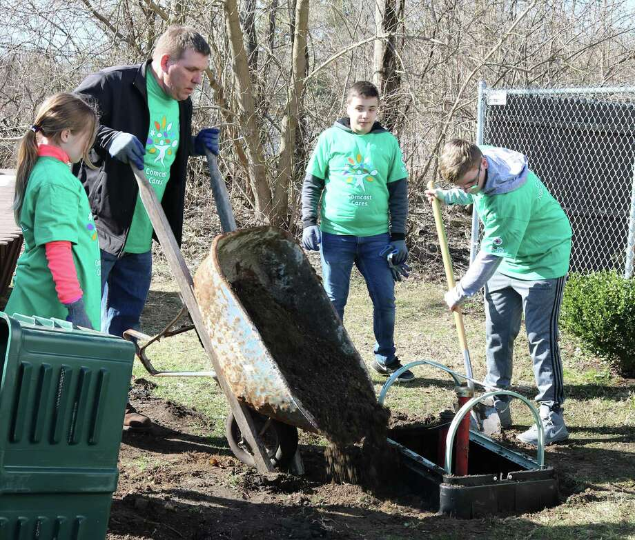 About 70 Comcast volunteers spruced up the Danbury Animal Welfare Society at an event last weeekend. Photo: / Contributed Photo