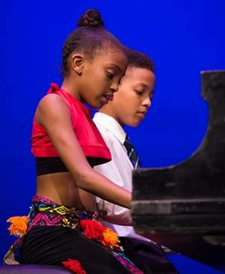 "Playing ""Heart and Soul"" are brother and sister Jason and Pillar Coates. Photo:       For The Telegraph"