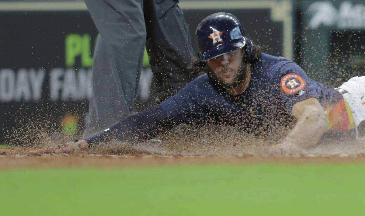 Houston Astros center fielder Jake Marisnick (6) scores off of a sacrifice bunt by Houston Astros second baseman Jose Altuve (27) in the bottom of the third inning against the Oakland Athletics on Sunday, April 29, 2018, in Houston.