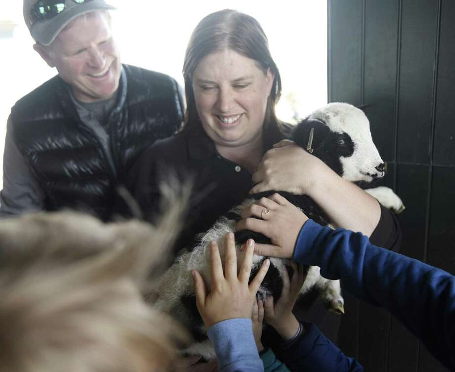 """Lisa Monachelli, Director of Education at Stamford Museum & Nature Center, holds a lamb during the """"Spring at the Farm"""" presentation at Greenwich Point Park's Innis Arden Cottage in Old Greenwich, Conn. Sunday, April 29, 2018. Monachelli entertained an enthusiastic crowd by showing a duckling, chick and lamb. Photo: Tyler Sizemore / Hearst Connecticut Media / Greenwich Time"""