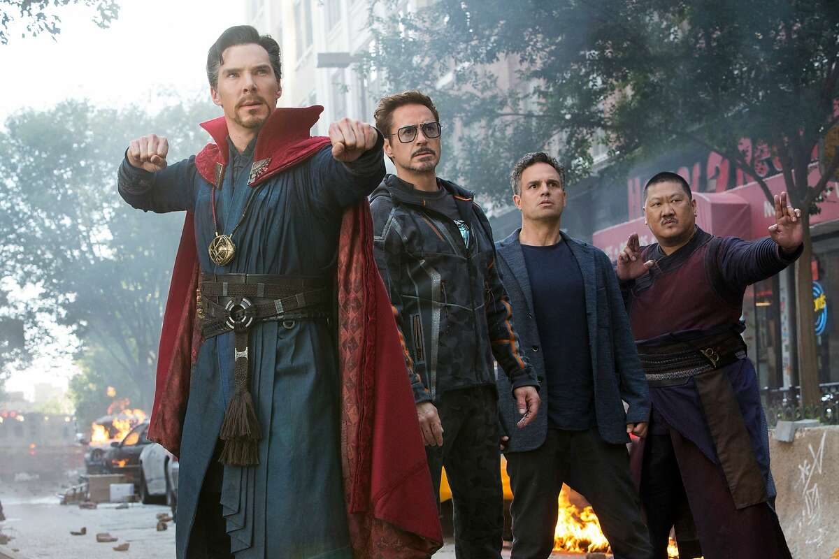 """This image released by Marvel Studios shows, from left, Benedict Cumberbatch, Robert Downey Jr., Mark Ruffalo and Benedict Wong in a scene from """"Avengers: Infinity War."""" (Marvel Studios via AP)"""