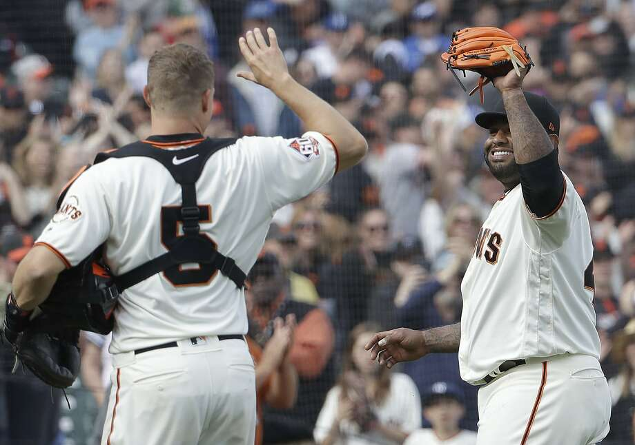 San Francisco Giants' Pablo Sandoval, right, high-fives catcher Nick Hundley (5) after pitching against the Los Angeles Dodgers during the ninth inning of a baseball game in San Francisco, Saturday, April 28, 2018. The Dodgers won 15-6. (AP Photo/Jeff Chiu) Photo: Jeff Chiu / Associated Press