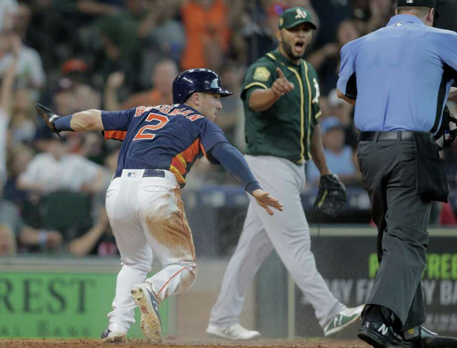 Houston Astros third baseman Alex Bregman (2) reacts to sliding safe at home, putting the Astros ahead 4-3 over Oakland Athletics at Minute Maid Park on Sunday, April 29, 2018, in Houston. Photo: Elizabeth Conley, Houston Chronicle / © 2018 Houston Chronicle