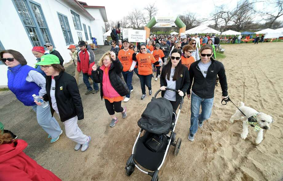 Walkers begin the 2.4-mile Connecticut Food Bank 2018 Walk Against Hunger at Lighthouse Point Park in New Haven Sunday. Photo: Arnold Gold / Hearst Connecticut Media / New Haven Register