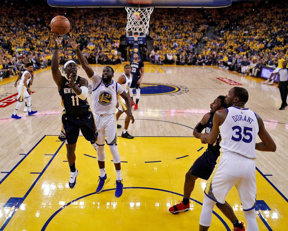 Jrue Holiday (11) puts up a shot defended by Draymond Green (23) in the first half as the Golden State Warriors played the New Orleans Pelicans in Game 1 of the second round of the Western Conference Finals at Oracle Arena in Oakland, Calif., on Saturday, April 28, 2018. Photo: Carlos Avila Gonzalez / The Chronicle
