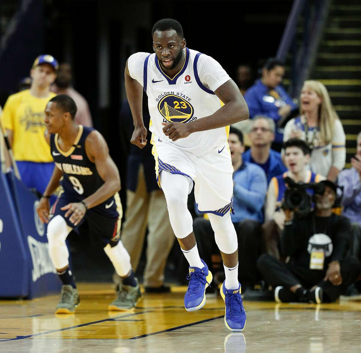 Golden State Warriors' Draymond Green runs up court in the third quarter during game 1 of round 2 of the Western Conference Finals between the Golden State Warriors and the New Orleans Pelicans at Oracle Arena on Saturday, April 28, 2018 in Oakland, Calif.