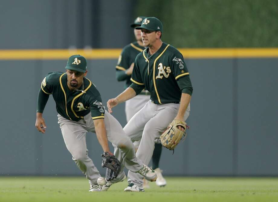 50d874b25 Oakland Athletics shortstop Marcus Semien (10) recovers a ball he dropped  hit by Houston