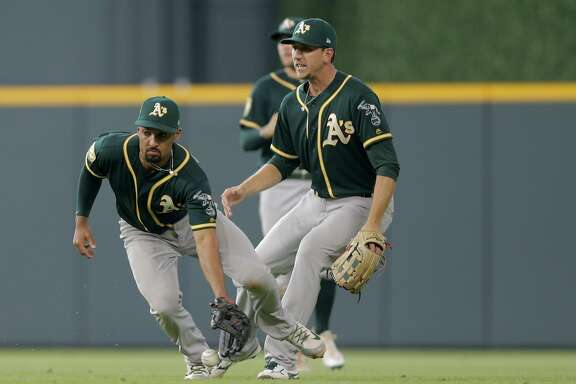 Oakland Athletics shortstop Marcus Semien (10) recovers a ball he dropped hit by Houston Astros catcher Brian McCann (16) giving Houston Astros third baseman Alex Bregman (2) a chance to score in the bottom of the seventh inning ( Elizabeth Conley / Houston Chronicle )