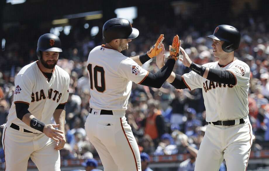 San Francisco Giants' Evan Longoria (10) is met at the plate after driving in Buster Posey, right, and Brandon Belt, left, with a three-run home run during the first inning of a baseball game against the Los Angeles Dodgers, Sunday, April 29, 2018, in San Francisco. (AP Photo/Marcio Jose Sanchez) Photo: Marcio Jose Sanchez / Associated Press
