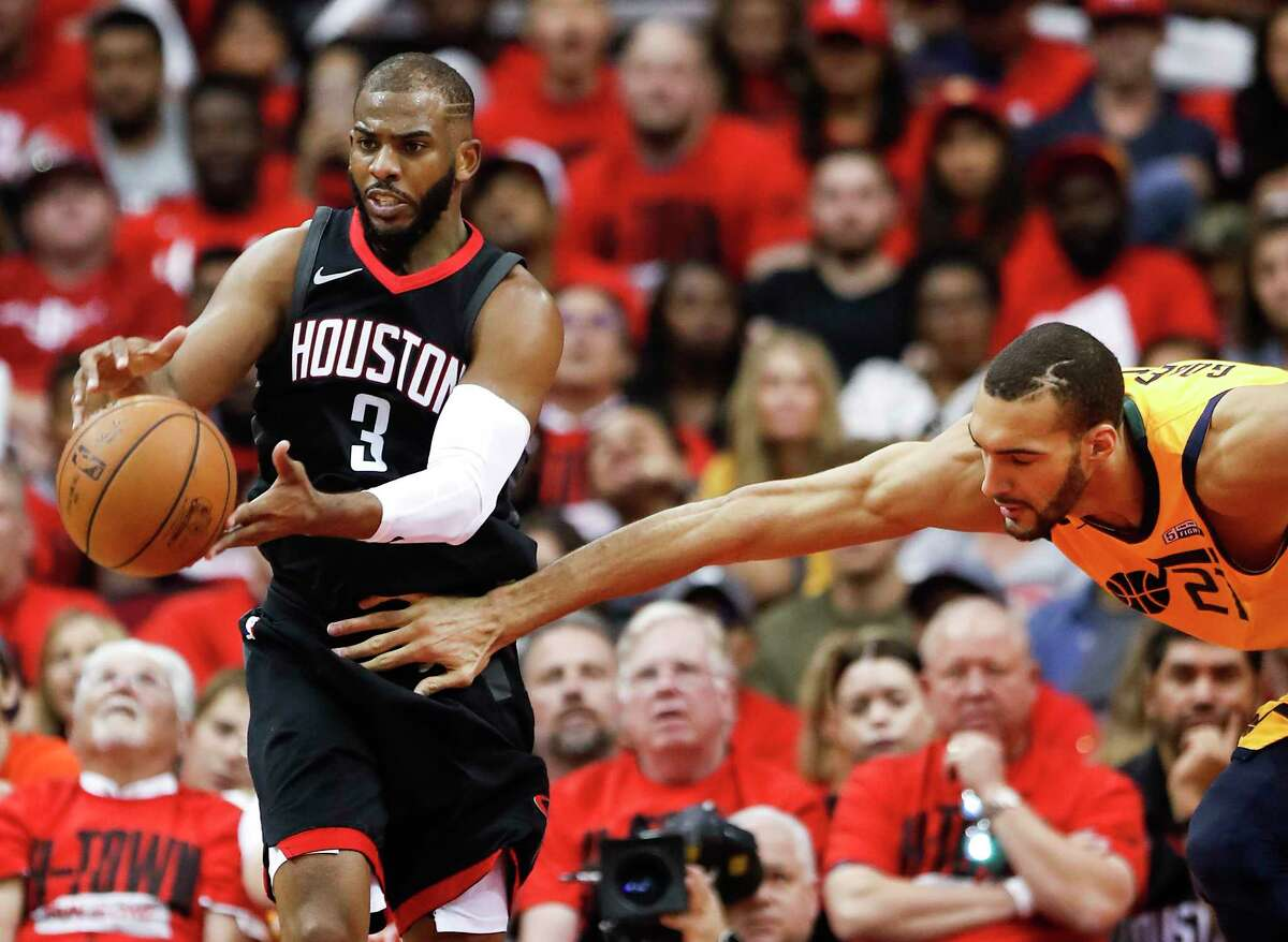 Houston Rockets guard Chris Paul (3) pulls a loose ball away from Utah Jazz center Rudy Gobert (27) during the second half in Game 1 of an NBA basketball second-round playoff series at Toyota Center on Sunday, April 29, 2018, in Houston.