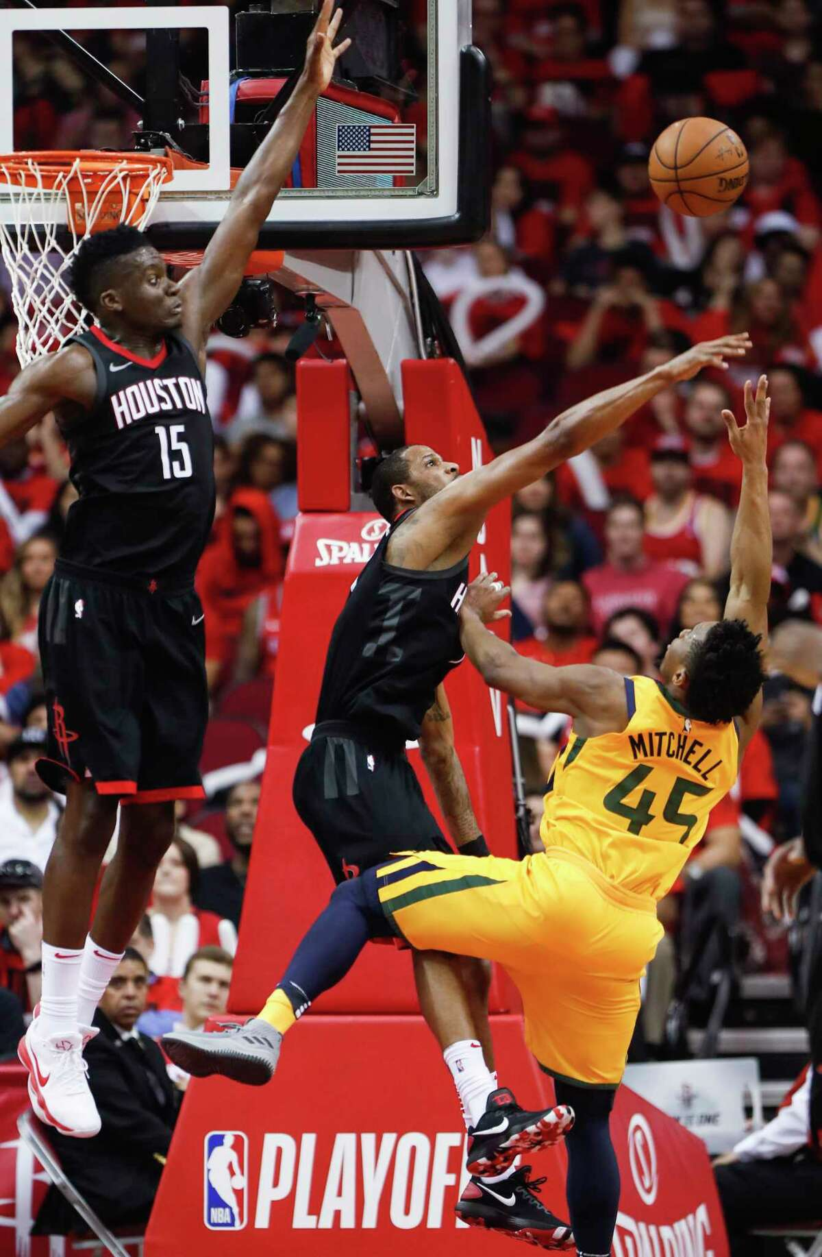 Houston Rockets center Clint Capela (15) and forward Trevor Ariza (1) defend a shot by Utah Jazz guard Donovan Mitchell (45) during the second half in Game 1 of an NBA basketball second-round playoff series at Toyota Center on Sunday, April 29, 2018, in Houston.