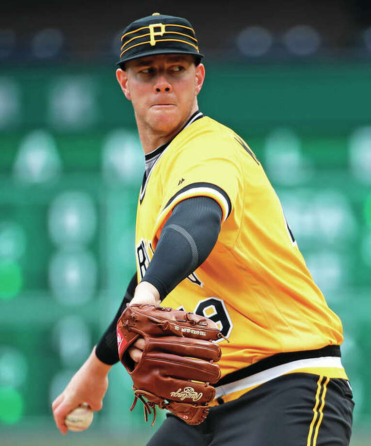 Pirates rookie pitcher Nick Kingham took a perfect game into the seventh inning against the Cardinals in his first major league start Sunday in Pittsburgh. The Pirates won 5-0. Photo:       Associated Press