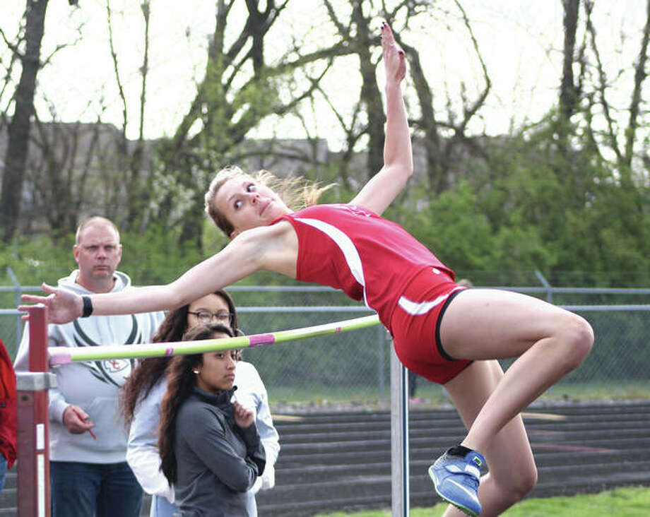 Alton senior Katie Mans clears the bar at 5 feet, 4 inches on her first attempt Tuesday at the Madison County Meet in Highland. Mans, who will jump at Illinois next season, won the event at 5-4 to become a four-time MadCo champ. Photo:       Greg Shashack / The Telegraph