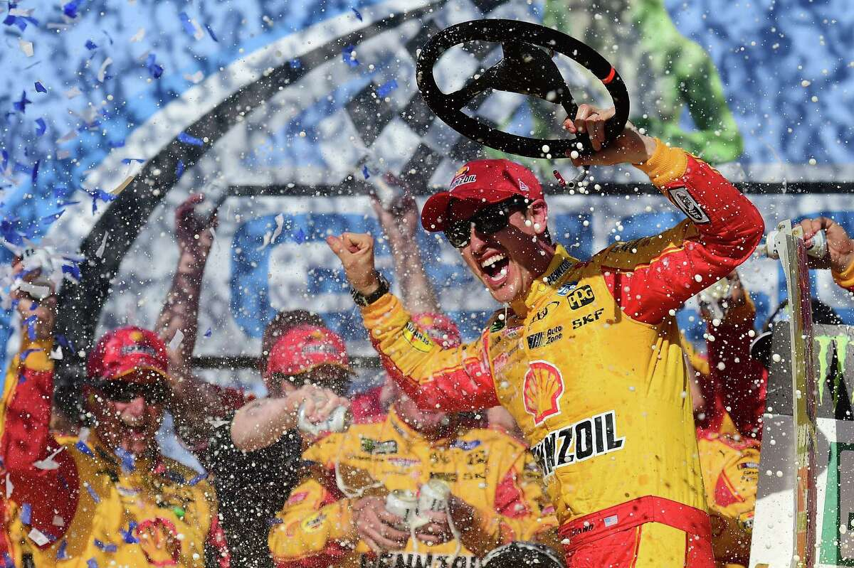 TALLADEGA, AL - APRIL 29: Joey Logano, driver of the #22 Shell Pennzoil/Autotrader Ford, celebrates in Victory Lane after winning the Monster Energy NASCAR Cup Series GEICO 500 at Talladega Superspeedway on April 29, 2018 in Talladega, Alabama. (Photo by Jared C. Tilton/Getty Images)