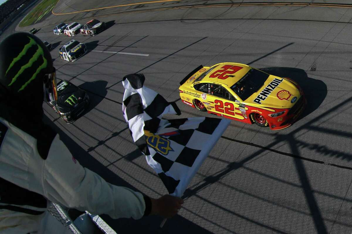 TALLADEGA, AL - APRIL 29: Joey Logano, driver of the #22 Shell Pennzoil/Autotrader Ford, takes the checkere flag to win the Monster Energy NASCAR Cup Series GEICO 500 at Talladega Superspeedway on April 29, 2018 in Talladega, Alabama. (Photo by Sean Gardner/Getty Images)