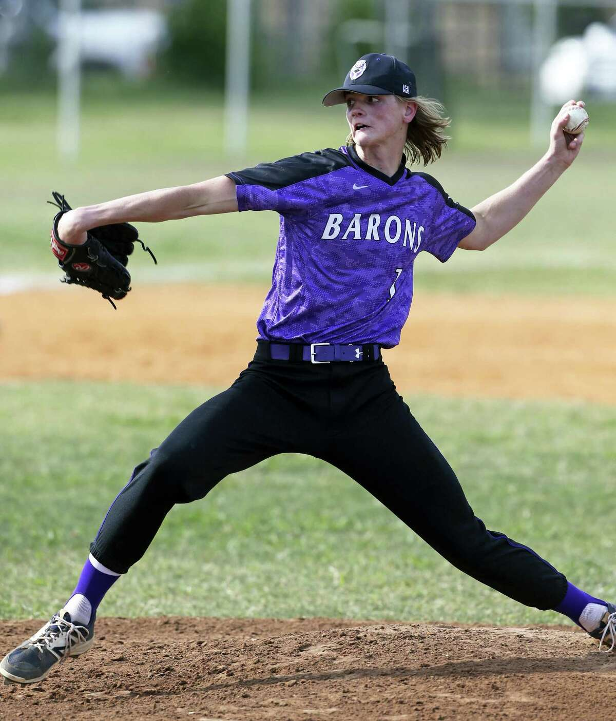 Sam Walbridge pitches for St. Mary's Hall as his team plays at Holy Cross on April 24, 2018.