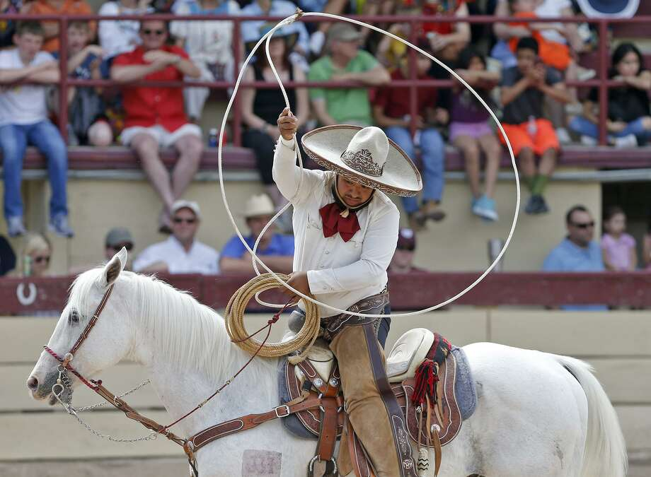 Nortenos de Houston charro Jesus Flores takes part in the  team roping event during the Day in Old Mexico and Charreada last year. Photo: Staff File Photo / © 2018 San Antonio Express-News