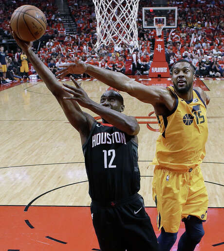 Houston Rockets forward Luc Mbah a Moute (12) drives to the basket as Utah Jazz forward Derrick Favors defends during the second half in Game 1 of an NBA basketball second-round playoff series, Sunday, April 29, 2018, in Houston. Houston won 110-96. (AP Photo/Eric Christian Smith) Photo: Eric Christian Smith, Associated Press / FR171023 AP