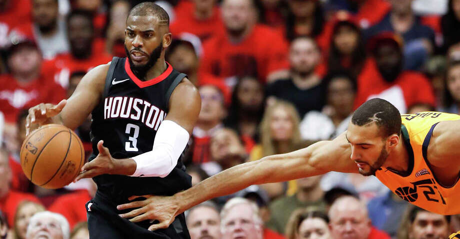 Houston Rockets guard Chris Paul (3) pulls a loose ball away from Utah Jazz center Rudy Gobert (27) during the second half in Game 1 of an NBA basketball second-round playoff series at Toyota Center on Sunday, April 29, 2018, in Houston. ( Brett Coomer / Houston Chronicle ) Photo: Brett Coomer/Houston Chronicle