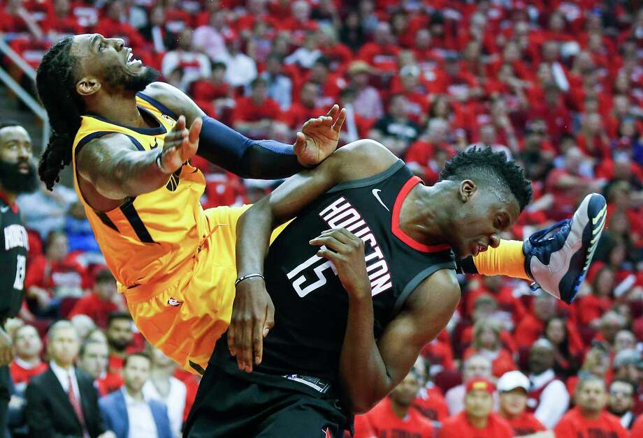 Utah Jazz forward Jae Crowder (99) and Houston Rockets center Clint Capela (15) collide as Crowder goes to the basket and is called for an offensive foul during the first half in Game 1 of an NBA basketball second-round playoff series at Toyota Center on Sunday, April 29, 2018, in Houston. Photo: Brett Coomer, Houston Chronicle / © 2018 Houston Chronicle