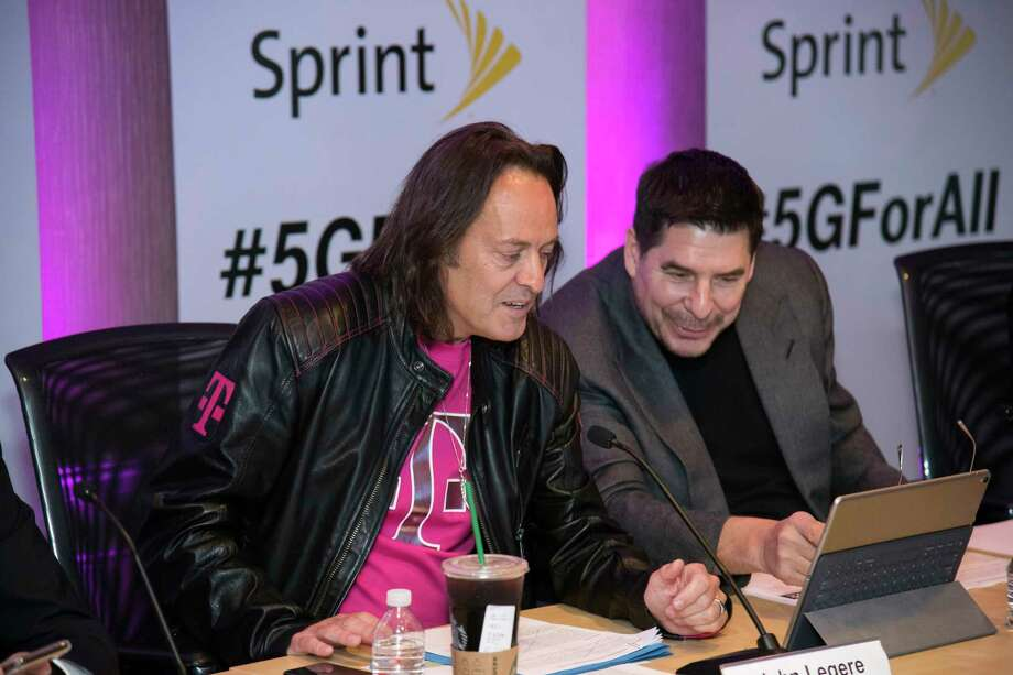 T-Mobile CEO John Legere, left, and Sprint CEO Marcelo Claure take questions from Twitter on Sunday April 29, 2018, in New York during a call announcing that the companies will combine creating a fierce competitor in wireless, video, and broadband able to deliver lower prices and greater competition. (Charles Sykes/AP Images for T-Mobile and Sprint) Photo: Charles Sykes / AP Images
