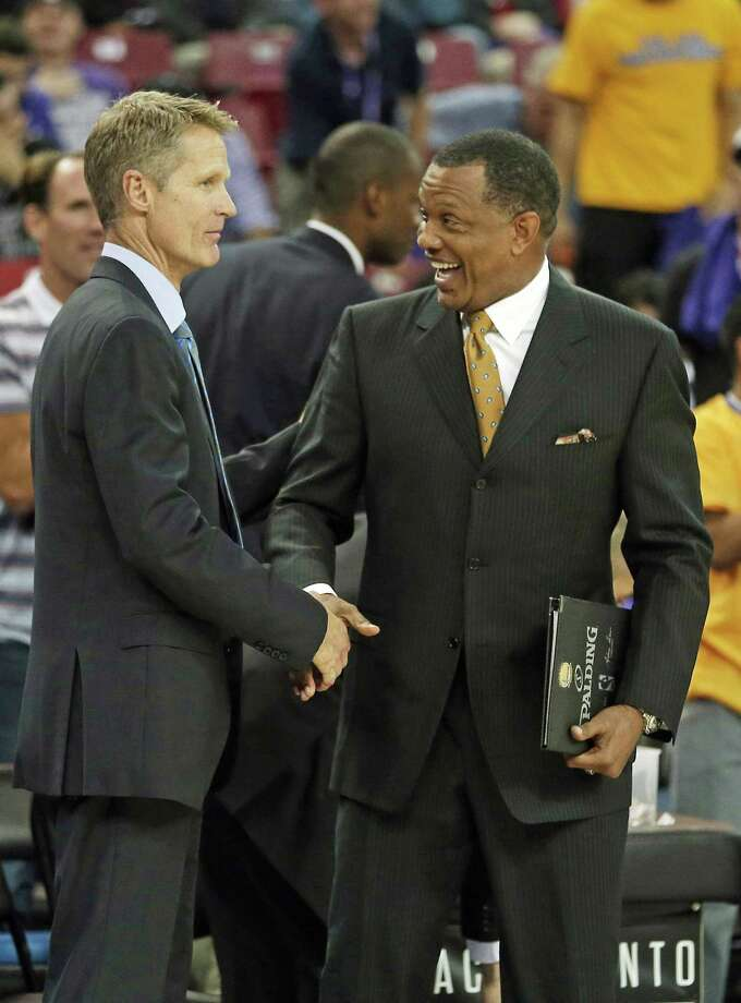 Golden State Warriors head coach Steve Kerr, left, receives congratulations from assistant coach Alvin Gentry after defeating the Sacramento Kings 97-77 in an NBA basketball game in Sacramento, Calif., Wednesday Oct. 29, 2014. This was Kerr's first win as the Warriors, after replacing Mark Jackson during the off season. Photo: Rich Pedroncelli / AP / AP