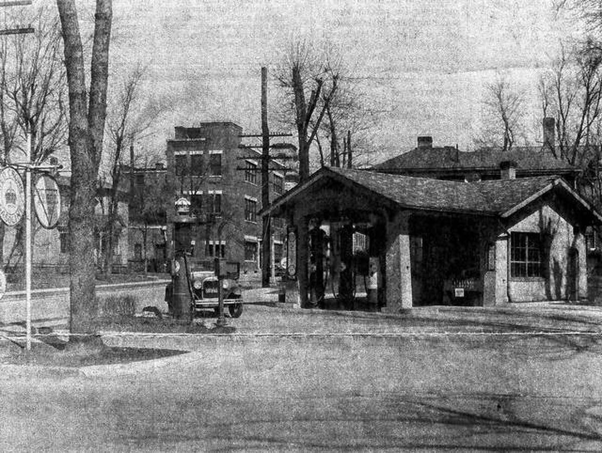 A Ford Model A sits near one of the gravity-flow gas pumps at Withee Service Station No. 7 at West College Avenue and South West Street in the early 1930s.