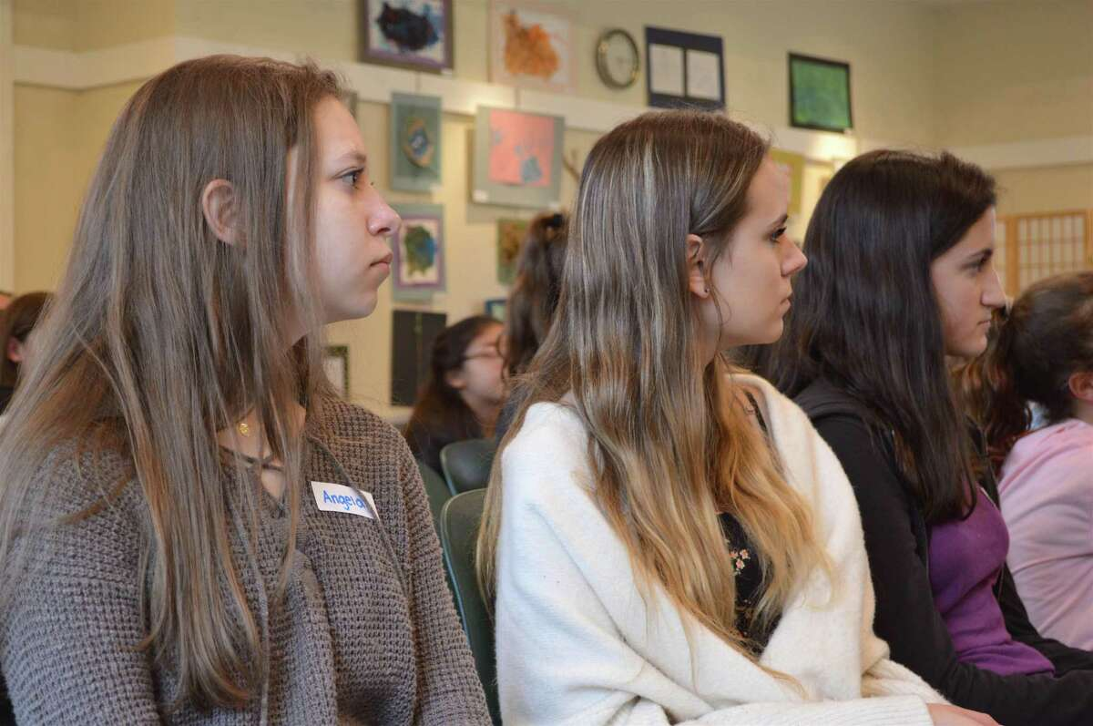 Listening and learning are, from left, Angela Malynovych, 15, Emily Ryklin, 15, and Jordan Mallis, 14, all of Stamford, at the local nonprofit LiveGirl's leadership summit