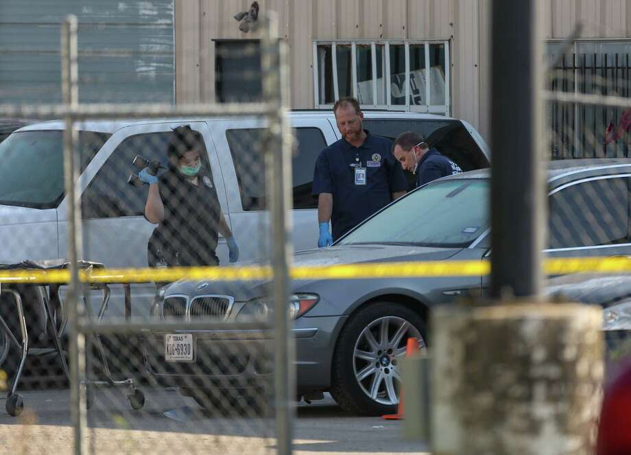 The Houston Police Department investigates the scene where two men were fatally shot at 7676 North Freeway Monday, April 30, 2018, in Houston. Photo: Godofredo A. Vasquez, Houston Chronicle