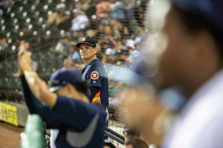 **EMBARGO: No electronic distribution, Web posting or street sales before MONDAY 3 a.m. ET APRIL 30, 2018. No exceptions for any reasons. EMBARGO set by source.** Sig Mejdal, a sabermetrics analyst for the Houston Astros, watches the action from the dugout steps of the team's Class AA affiliate, the Corpus Christ Hooks, in Corpus Christi, Texas, April 25, 2018. After spending last summer as a first base coach at the bottom rung of the Astros' farm system, Mejdal is convinced that young players crave the information that tech-savvy teams can offer. (Michael Starghill Jr./The New York Times)