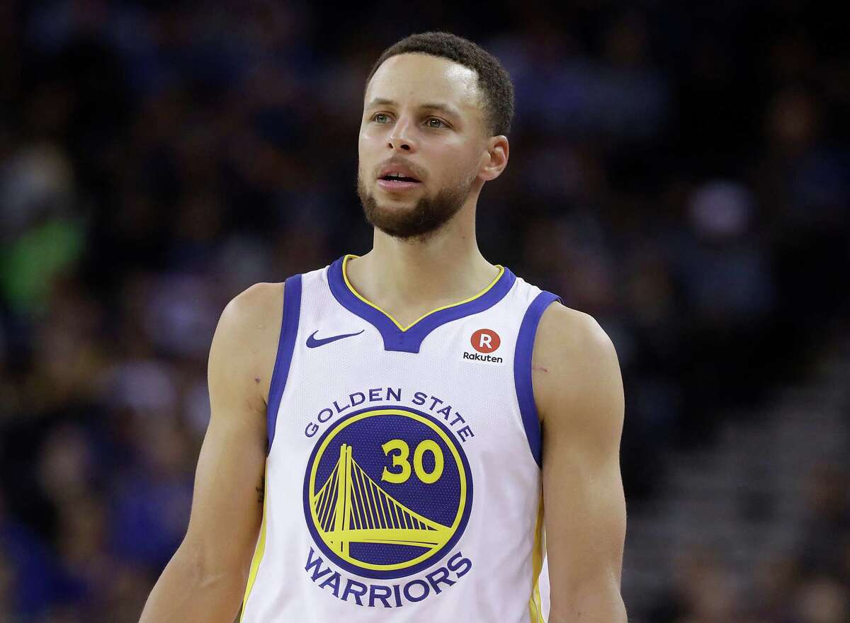 This March 6, 2018 file photo shows Golden State Warriors guard Stephen Curry during an NBA basketball game against the Brooklyn Nets in Oakland, Calif. Sony Pictures Entertainment announced Monday, April 23, that it has struck a deal with the Golden State Warriors All-Star guard to produce television, film and possibly gaming projects. (AP Photo/Jeff Chiu, File)