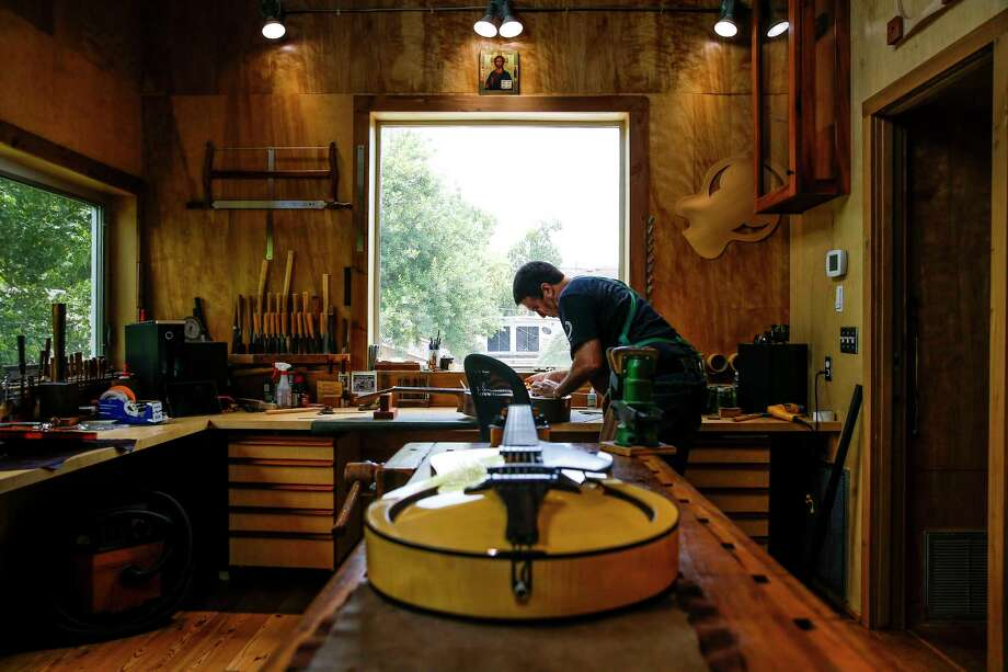 Stephen Marchione, owner of Marchione Guitars, works on a guitar out of his shop in the Montrose area. Photo: Michael Ciaglo, Staff / © 2016  Houston Chronicle