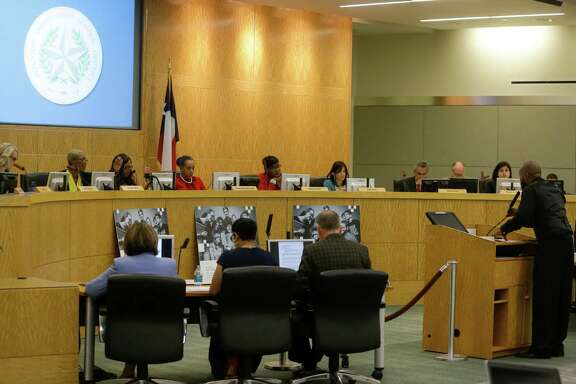 In this April file photo, Travis McGee, an HISD parent and a Sunnyside activist, speaks to the Houston ISD board during meeting. ( Melissa Phillip / Houston Chronicle )