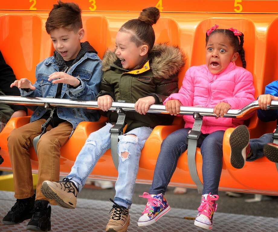 From left; Brandon Rodriguez, 7, Cayson Rodriguez, 5, and Brianna Lopez, 4, all of Bridgeport, have differing reactions as they go on one of the rides at the annual McKinley Elementary School Carnival at Jennings Beach in Fairfield, Conn. on Sunday, April 29, 2018. Photo: Brian A. Pounds / Hearst Connecticut Media / Connecticut Post