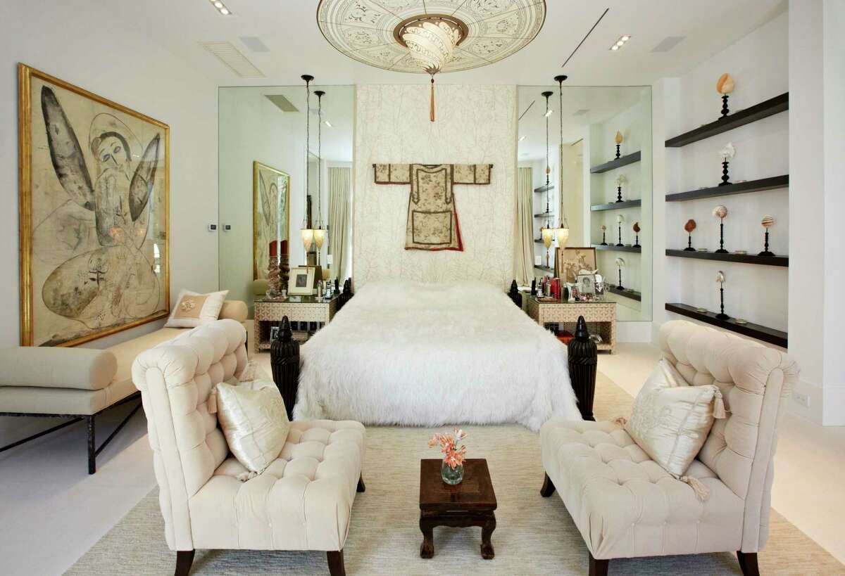 The master bedroom has a faux Tibetan sheepskin bedspread and shelves along one wall for art and mementos.