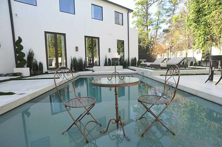 During parties, the swimming pool becomes a dance floor when it's covered with a custom-made Lucite deck.