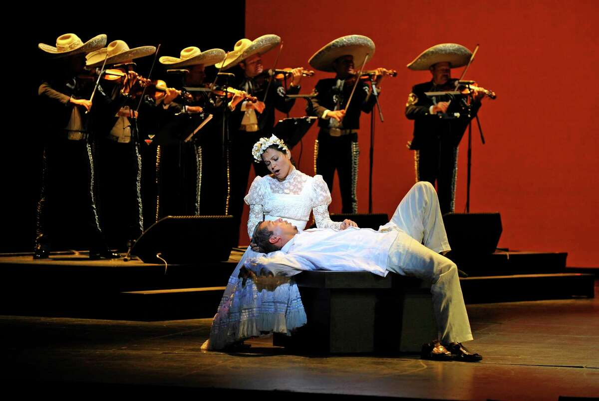 """Cruzar la Cara de la Luna (To Cross the Face of the Moon). Houston Grand Opera (HG0) production about Three generations of one family are divided by countries and cultures. As a Mexican-American family deals with the impending death of their patriarch, long-buried secrets are revealed. Music by Jos """"Pepe"""" Martinez. Lyrics by Jos """"Pepe"""" Martinez and Leonard Foglia. Book by Leonard Foglia Featuring Mariachi Vargas de Tecalitlan."""