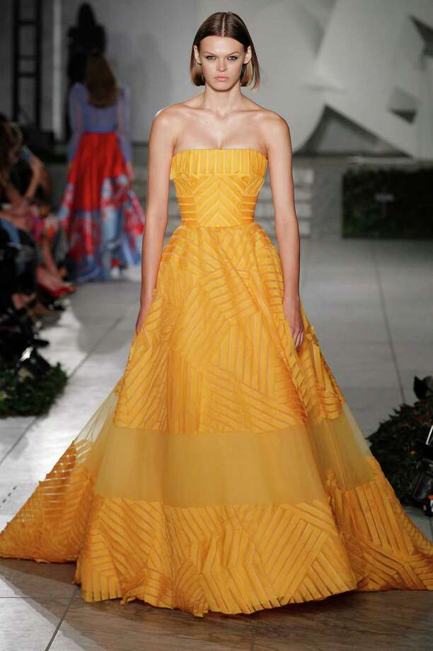 Carolina Herrera showed a marigold gown for Spring Summer 2018. Photo: (Photo By Catwalking/Getty Images), Contributor / 2017 Catwalking